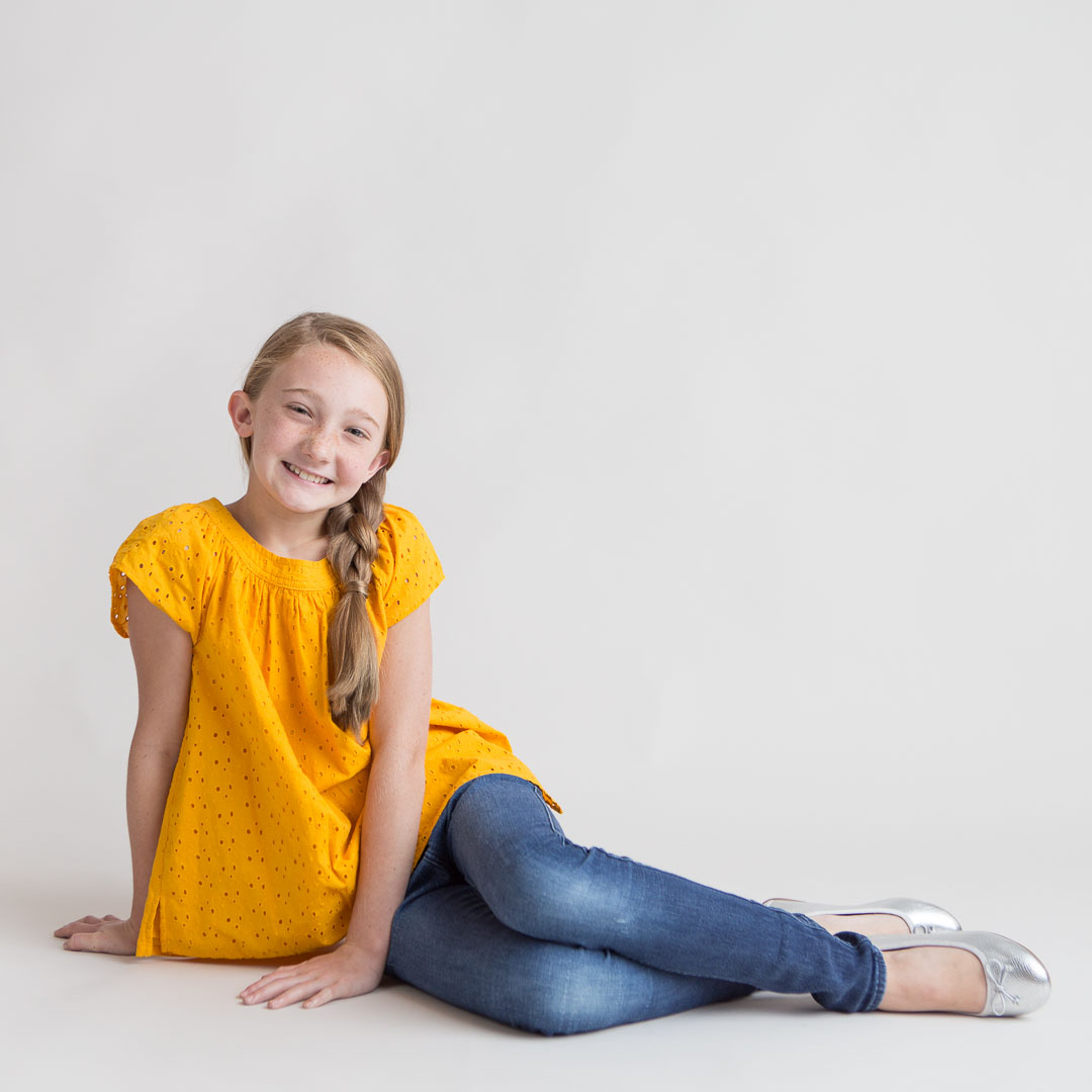 Child Headshots with young girl in yellow shirt