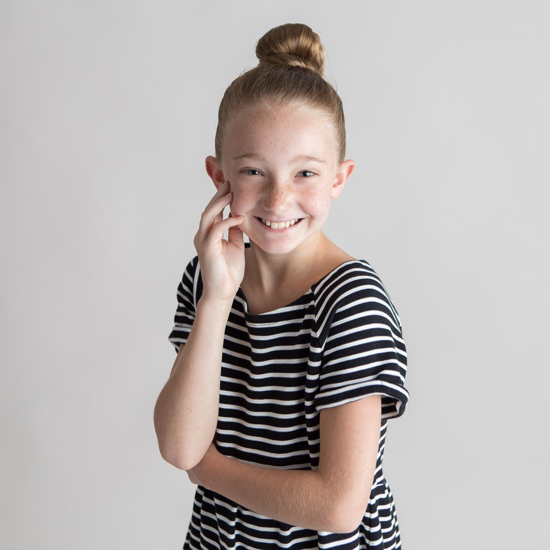 Laughing headshot of young girl in Suwanee, Georgia photography studio