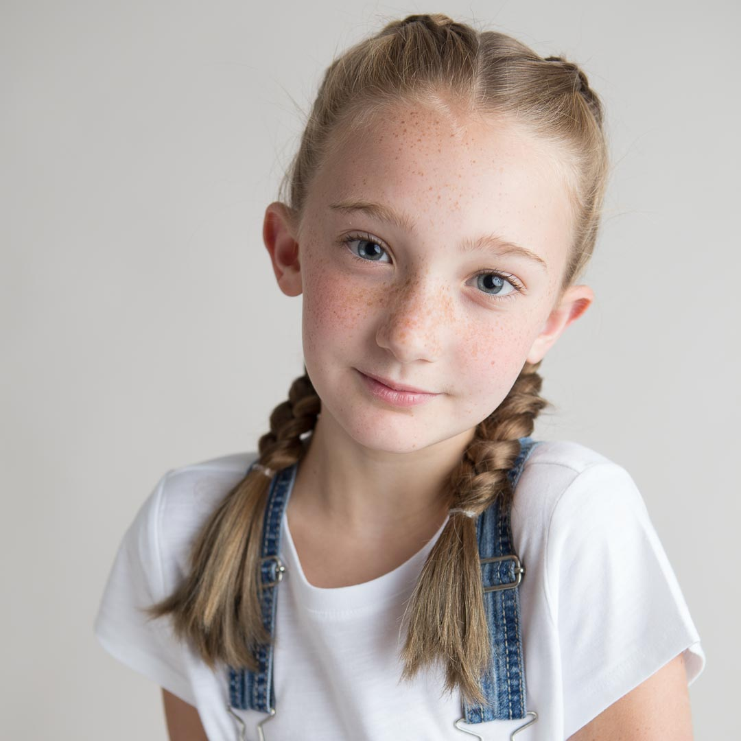 Children's Headshots with young girl in braids in Suwanee photography studio